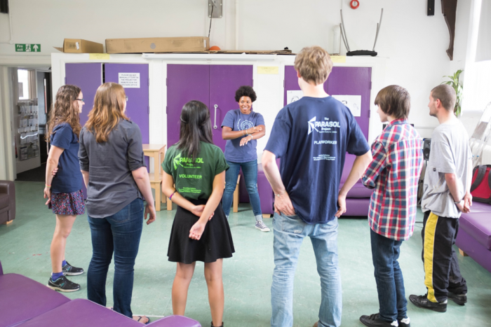 Image of group standing in circle