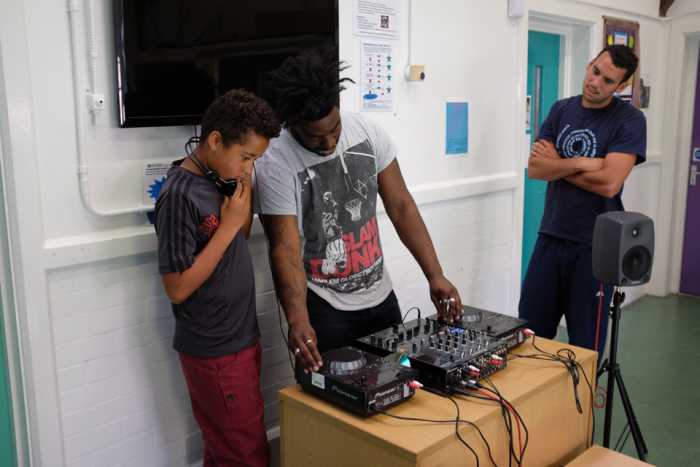 image of DJ tutor teaching participant