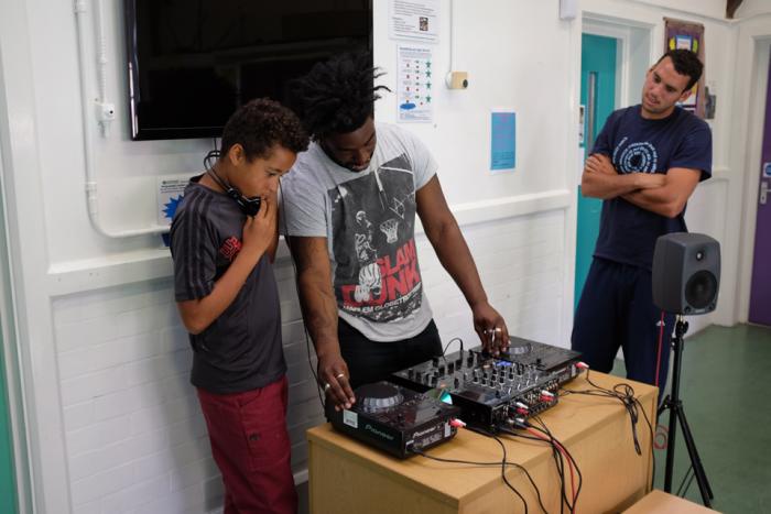 image of DJ tutor teaching participant