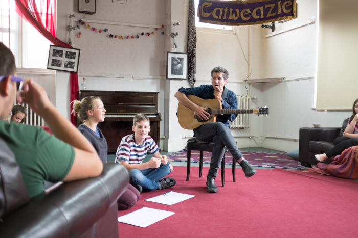 Image of guitar tutor teaching session